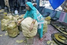 A woman packs vermicelli, a specialty eaten during the Muslim fasting month of Ramazan, at a factory in Kolkata, India.