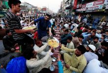 Volunteers distribute plates of boiled rice with potatoes to passers-by, who gathered to break their fast during the Muslim holy month of Ramazan in Rawalpindi, Pakistan.