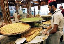 A vendor prepares traditional sweets, during the Muslim fasting month of Ramazan in Baghdad, Iraq.