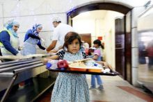 Children receive their meals for iftar, or the evening meal, to break fast, at Tkiyet Um Ali, a humanitarian services center, in Amman, Jordan.