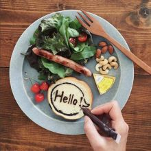 Greetings on a plate of breakfast. What a conversation starter!
