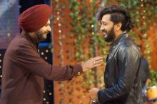 Navjot Singh Sidhu shares a light moment with Riteish.