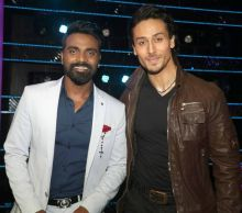 Here, Tiger poses with Remo D'Souza, the director of The Flying Jatt and mentor in Dance Plus 2.