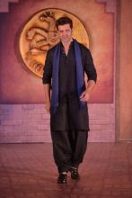 Hrithik Roshan walking down the stage, looking dapper in traditional clothes.