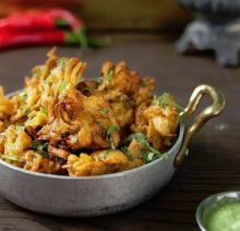 To make cauliflower or gobhi pakoras, you'll need to steam or blanch the cauliflower florets first to make sure they are soft and will cook completely when you fry them.