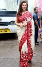 Madhuri Dixit looked gorgeous in this red and white sari. We will surely miss the dancing diva on TV once the show wraps up.