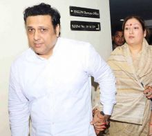 Krushna's materal uncle and aunt--Govinda and Sunita.