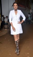 Sonakshi looked stunning in a little white dress and black gladiators.