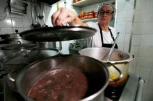 A cook prepares the Brazilian traditional dish called feijoada (black bean and meat stew) at the Bar do Mineiro in Rio de Janeiro. Feijoada is a hearty one-pot meal enjoyed by everyone in Brazil.