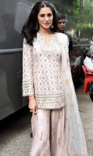 Nargis looks graceful in this cream-coloured outfit.