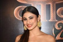 All smiles: Is Mouni smiling all the nervousness with that big smile?