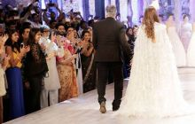 The front row full of Bollywood's 'who's who' cheers as Shweta Bachchan Nanda walks the ramp with the designers.