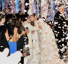 Amitabh Bachchan is seen talking to his daughter, Shweta, while the crowd cheers.