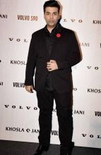 Karan Johar, smouldering in a suit, at Abu Jani and Sandeep Khosla's fashion event.