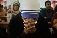 A nun offers prayers on Christmas day at a Church in Guwahati