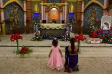 A woman and a child offer Christmas prayers at a Church in Guwahati.