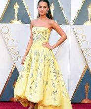 "Alicia Vikander This ever so pretty lemon yellow dress got a lot of attention for looking just like the iconic ball gown from Beauty and the Beast. And an interview revealed that this is just what this beauty was thinking, ""I think if you would've aske"