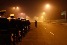 Indian coast guard soldiers march past Rajpath.