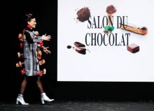 A model walks down the ramp in an outfit made of chocolate, at the fourth Salon du Chocolat festival in Brussels, Belgium. The festival presents the creations of chocolatiers, patissiers, and designers. The fashion show, Chocoladesalon, shows off some of