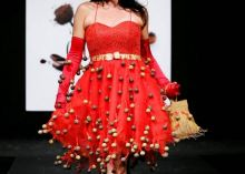 A model walks down the ramp in a chocolate candy outfit.