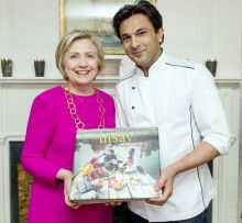 """Many might not be aware, but Vikas Khanna had shown his support for ex-Presidential candidate, Hillary Clinton. He gifted a copy to the Clintons, and Hillary thanked him with these words: """"UTSAV is the Majestic celebration of India""""."""