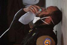 civil defence member breaths through oxygen masks, gas attack