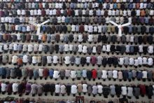 Students perform a prayer on the first day of the holy fasting month of Ramzan at Ar-Raudlatul Hasanah Islamic boarding school in Medan, North Sumatra, Indonesia.
