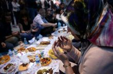 People pray before breaking their fast at the main shopping and pedestrian street of Istiklal on the first day of the holy fasting month of Ramzan in central Istanbul, Turkey.