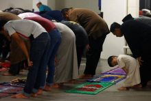 Muslims perform tarawih prayers at a mosque in Singapore.