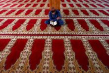 An Afghan man reads the Koran at a mosque in Kabul, Afghanistan.