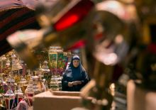 """A woman buys traditional metal Ramzan lanterns, """"Fanous Ramadan"""", a tradition in Egypt dating back to the Fatimid Caliphate to decorate homes, mosques, shops and streets during the holy month of Ramadan, at a popular market in Cairo, Egypt."""