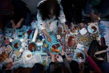 People break their fast at the main shopping and pedestrian street of Istiklal in central Istanbul, Turkey.