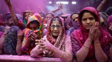 Women offer prayers inside a temple during Holi celebrations in Ahmedabad