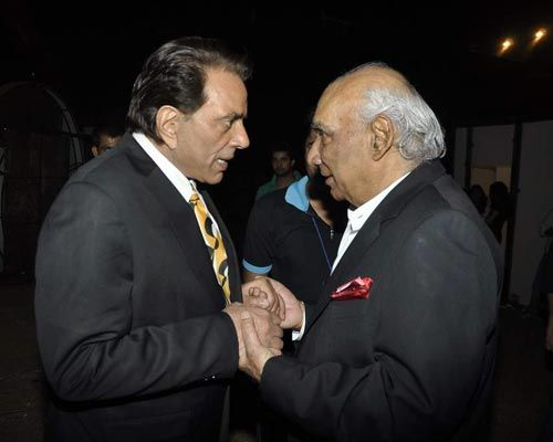 Dharmendra and Yash Chopra.