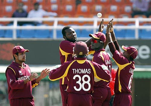 Sulieman Benn (center background) celebrates the wicket of Ireland opener Paul Stirling
