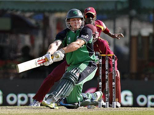 Ireland batsman Gary Wilson protests his dismissal as West Indies captain Darren Sammy places his hands on his shoulders
