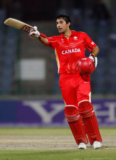 Canada batsman Jimmy Hansra raises his bat post his half-century