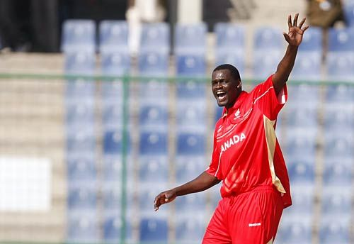 Canada's Henry Osinde celebrates the wicket of Kenya's David Obuya