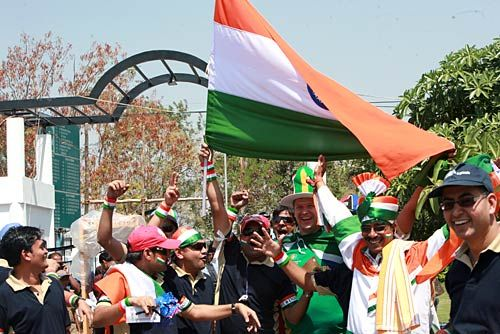 Indian cricket fans wave the Indian Tri-colour