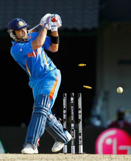 India's Virat Kohli is bowled out by West Indies paceman Ravi Rampaul