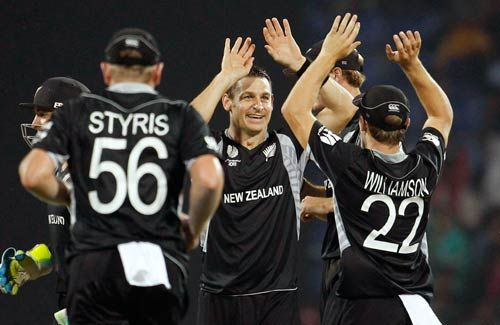 New Zealand offie Nathan McCullum (centre) celebrates the wicket of Pakistan batsman Umar Akmal