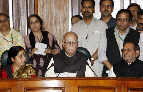 L K Advani addressing a press meet