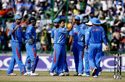 India leg-spinner Piyush Chawla celebrates the wicket of the Netherlands batsman Eric Szwarczynski