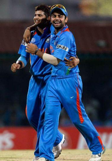 India's Suresh Raina (left) and Virat Kohli celebrate the wicket of West Indies' Darren Bravo