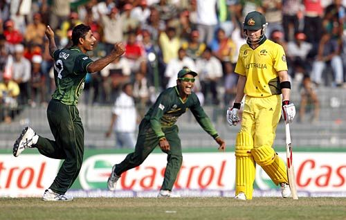 Pakistan all-rounder Abdul Razzaq (left) celebrates the dismissal of Australia batsman Michael Clarke