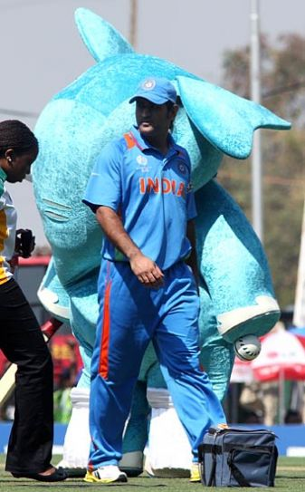 India captain Mahendra Singh Dhoni takes a walks past the World Cup mascot Stumpy