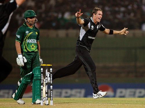 New Zealand pacer Tim Southee celebrates the wicket of Pakistan's Kamran Akmal