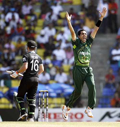 Pakistan bowler Umar Gul successfully appeals for the wicket of New Zealand batsman Jamie How
