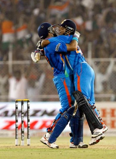 India's Yuvraj Singh (left) and Suresh Raina celebrate their win