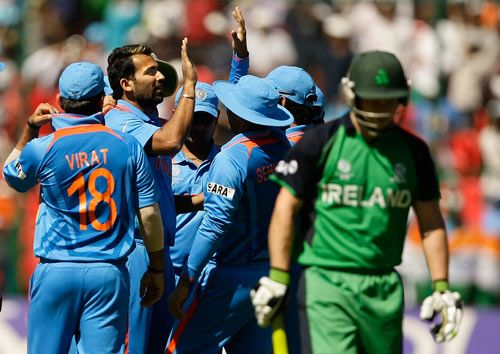 India's Zaheer Khan celebrates the wicket of Ireland's Ed Joyce